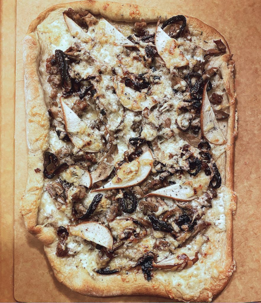 Smoked Duck Pizza with Fontina, Caramelized Sweet Onions, Pears & Rosemary