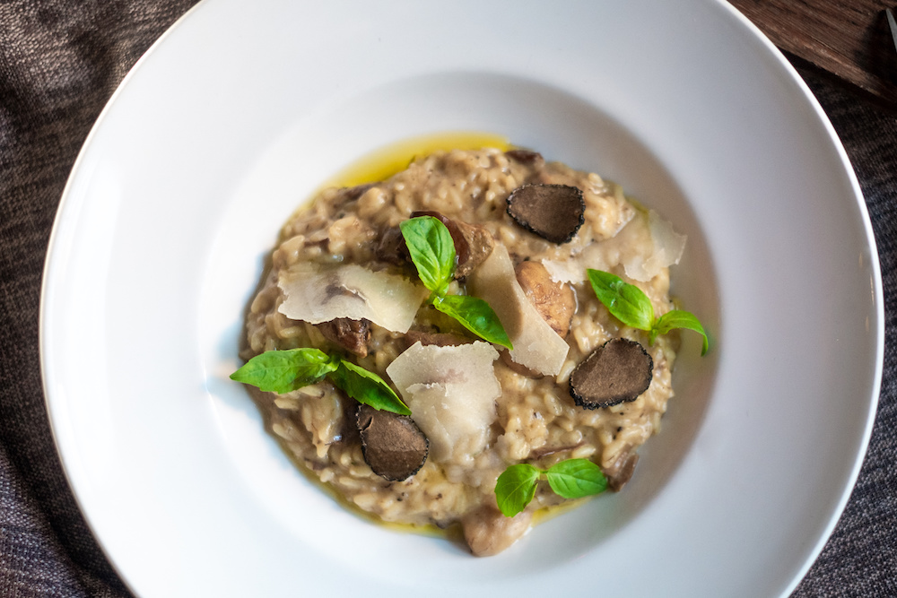 Risotto with truffles and wild mushrooms, Parmesan cheese, and basil